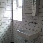 Wall hung basin with a wall mounted tap