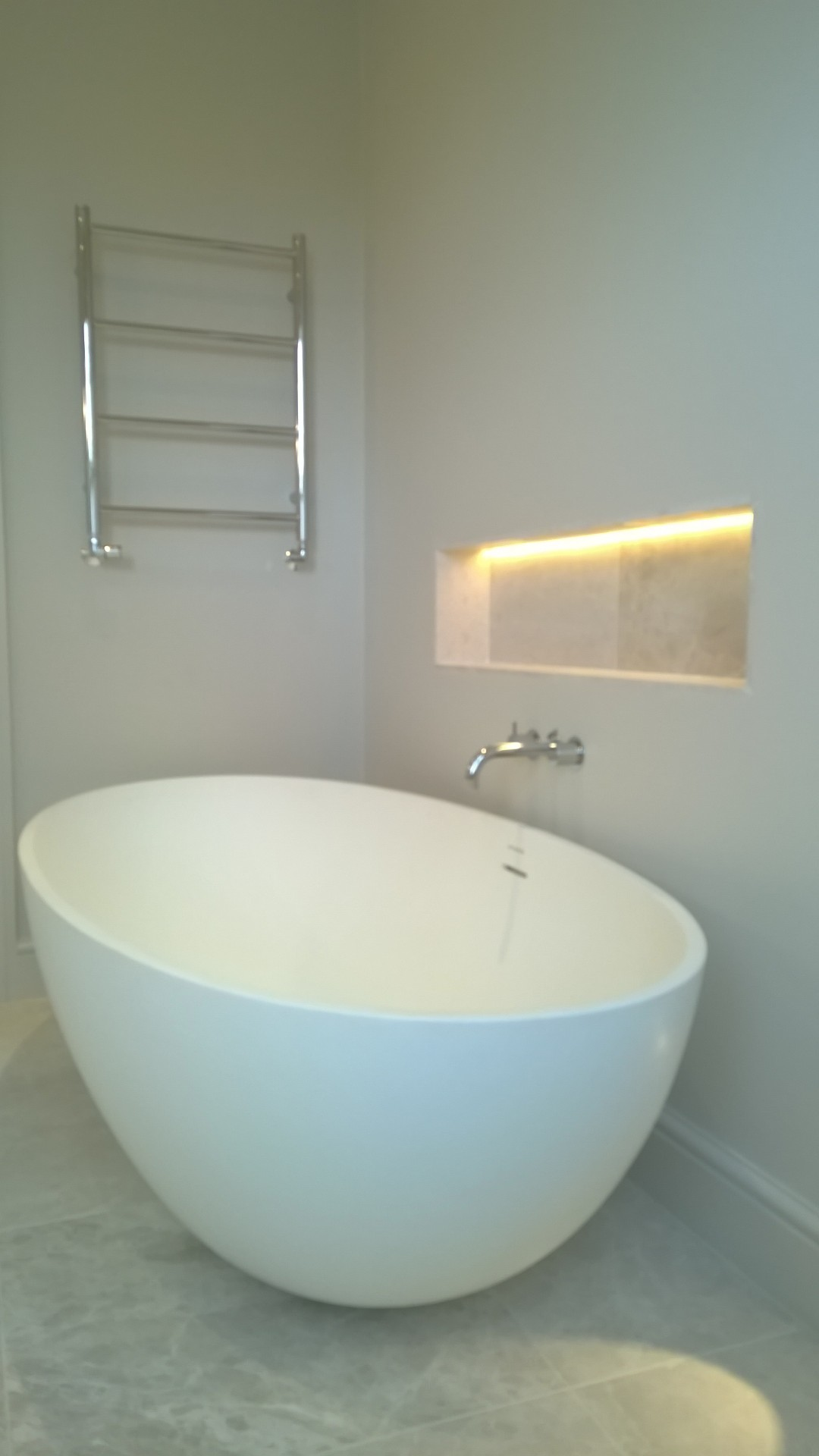 A free standing bath with a wall mounted bath filler tap