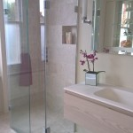 A shower lad wetroom shower screeen with a hinged panel