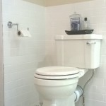 Traditional style close coupled WC with patterned floor tiles