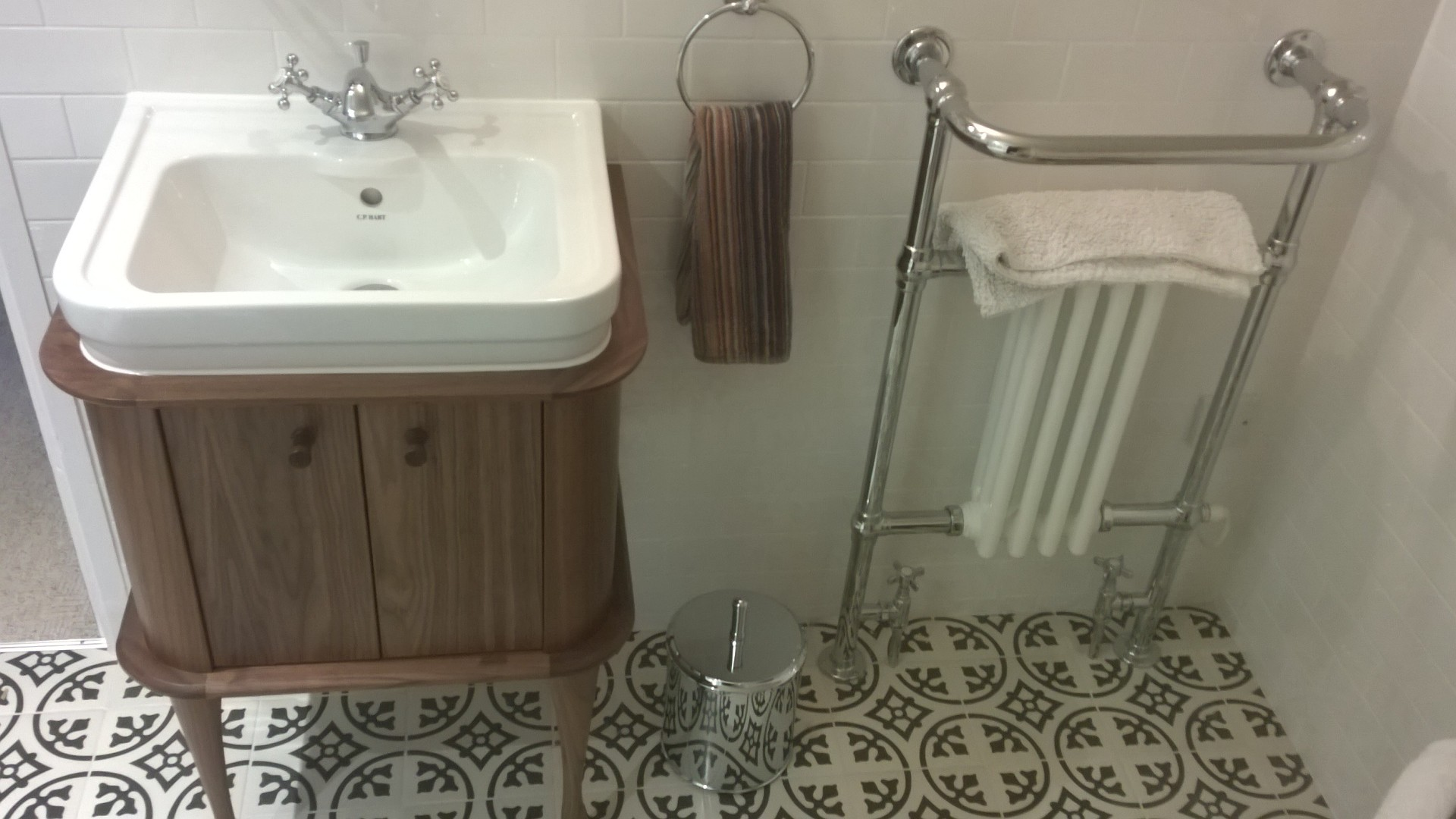 An oak basin unit with patterned floor tiles