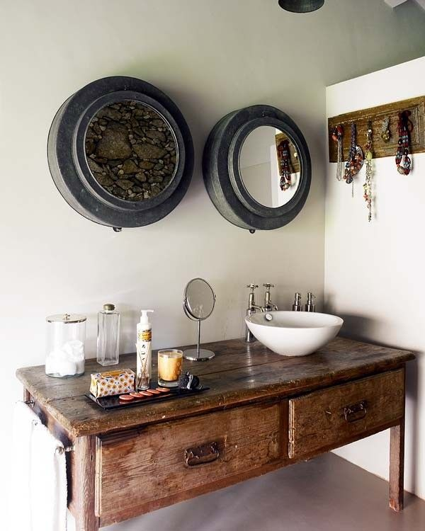 I love the use of old furniture as a basin unit. Putting a simple ceramic bowl and mixer tap onto an old wooden unit like this is stunning and practical.