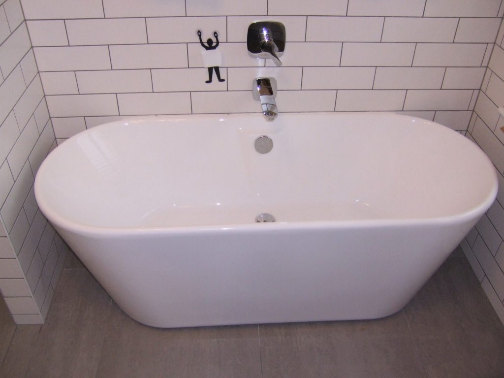 Picture of a free standing bath and wall mounted mixer tap.