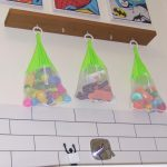 Picture of bath toys stored in nets abouve the bath
