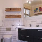 Picture of a wall hung WC on a chimney breast in a family bathroom