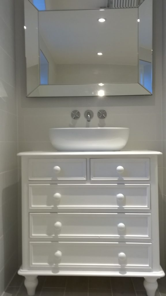 Vanity unit made out of a recliamed set of drawers with a counter top basin