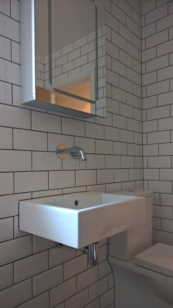 Traditional metro wall tiling with dark grey grout
