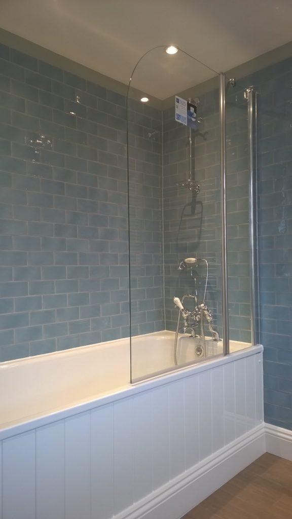 Light blue metro wall tiles and traditional steel bath