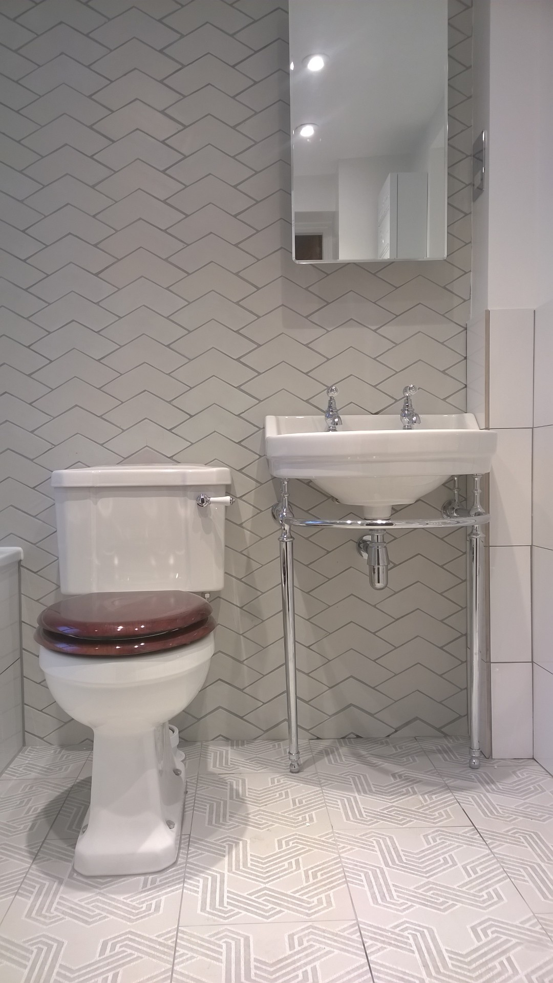 chevron wall tiling with burlington fittings | richmond bathrooms