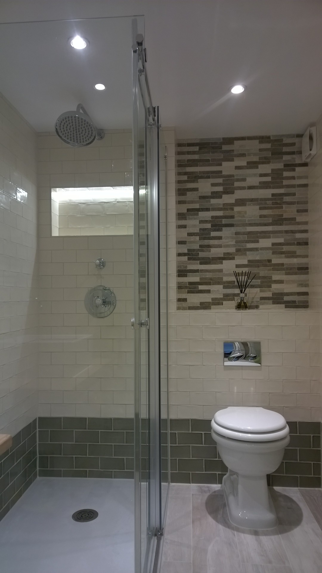 Walk in shower in an ensuite bathroom